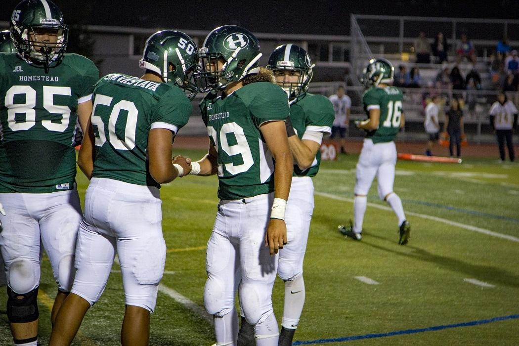 Senior+running+back+Luis+Caballero+celebrates+with+teammates+after+scoring+a+touchdown+in+the+first+half.%0A