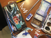 """Senior Zoie Smith used sticker paper from Michaels to create stickers with her friends over the summer. """"I printed out a bunch of whale [pictures] 'cause I think whales are pretty sick and I drew on the extras. (...) I have sticker anxiety so I don't actually stick them onto things, so I decided to trap them in the phone case,"""" Smith said."""