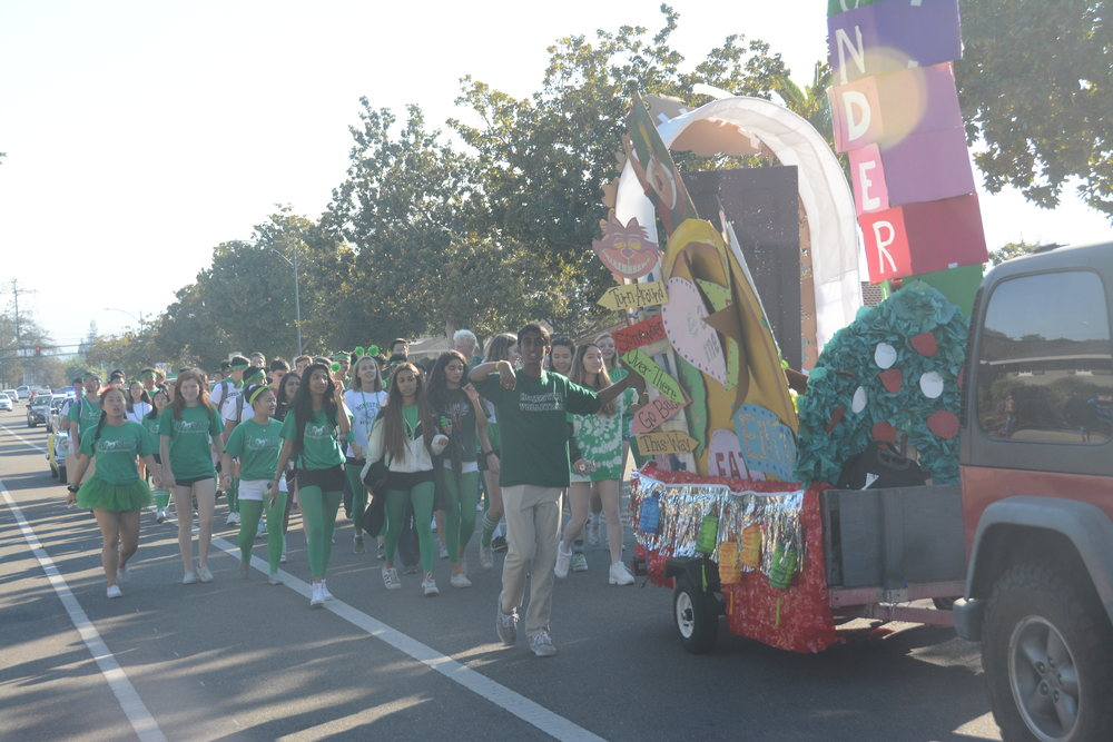 The+senior+class+following+behind+their+float