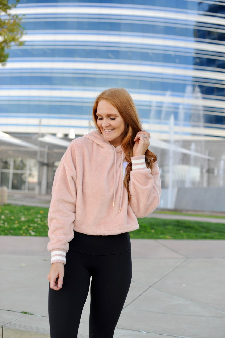 Fitness blogger Bella Hibbs in Pink workout sweater
