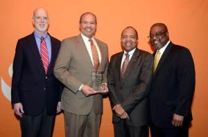 """Colorado Department of Human Services Executive Director Reggie Bicha (second from left) receives the national 2014 Casey Family Programs """"Excellence for Children Award"""" from William C. Bell, Casey Family Programs' president and CEO (far right) and Bob Watt, Casey Family Programs' chair of the board of trustees (left). Kevin Patterson, Governor Hickenlooper's Deputy Chief of Staff and Chief Administrative Officer, attended with Director Bicha."""