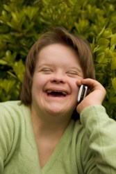 Woman with disability using cell phone