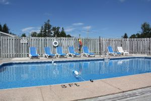 Outdoor Heated Swimming Pool at Hidden Acres Cottages