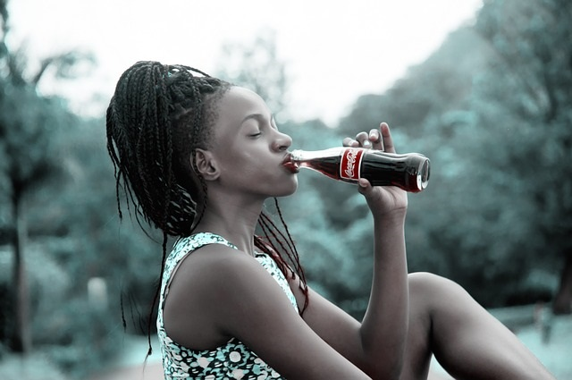 Girl drinking Coke
