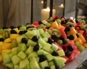 fruit bowl with candle and utah catering and cakes