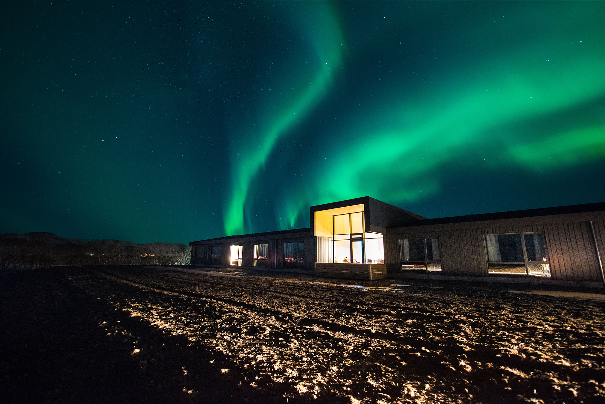 Northern Lights over Lilja Guesthouse   Hidden Iceland   Photo by Tom Archer