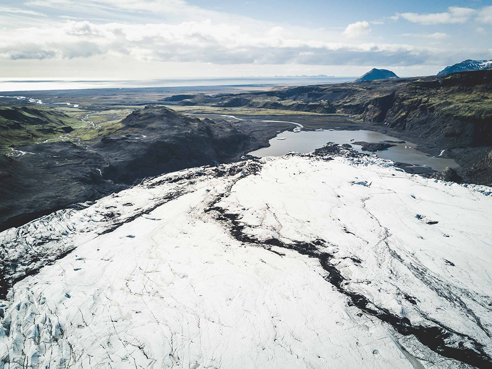 Sólheimajökull Glacier | South Coast: Fire & Ice Tour | Hidden Iceland | Photo by Norris Niman