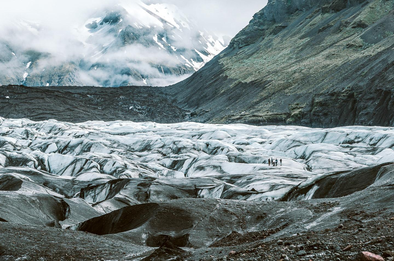 Group on Svínafellsjökull glacier. Hidden Iceland. Photo by Niklas Siemens. Feature