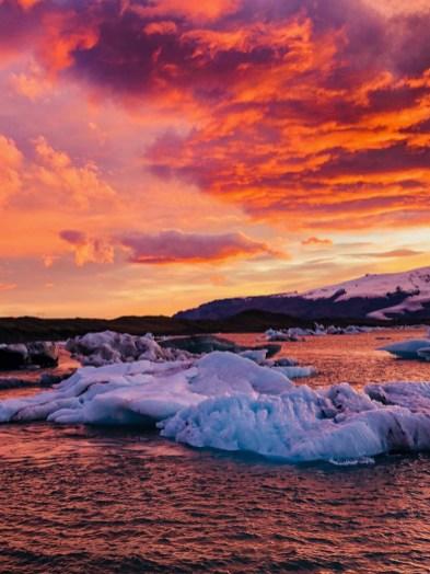 Firey sunset over Jökulsárlón glacier lagoon at sunrise. Photo by Scott Drummond, Hidden Iceland