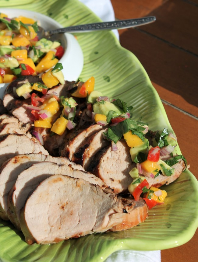 Pork tenderloin with mango-avocado salsa - a quick and colourful summer meal that can be grilled or done in the oven! Recipe on hiddenponies.com