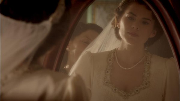Peggy in her flashback wearing a wedding dress.