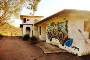 The abandoned Champagne Rancho House was once owned by a prominent breeder of quarter horses. It later burned down in a fire and sits rotting since.
