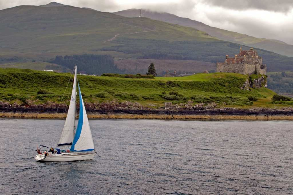 A yacht sailing in the Sound of Mull by Duart Castle on the Isle of Mull, Inner Hebrides. Picture Credit : Paul Tomkins / VisitScotland