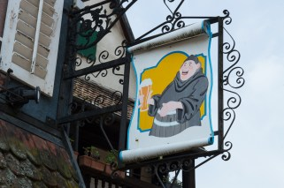 Sign with monch and beer in Ribeauvillé