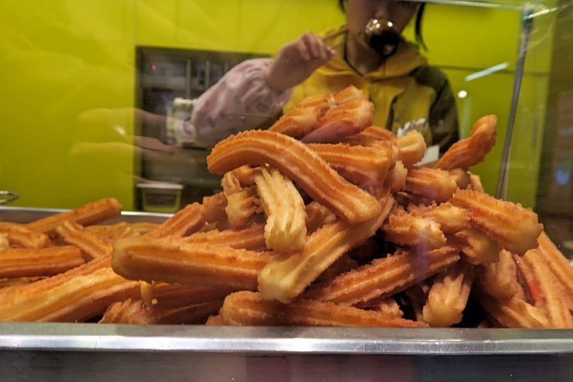 Churros made in China tasting like in Spain! A few shops down the street they were even selling Glühwein (mulled wine)!