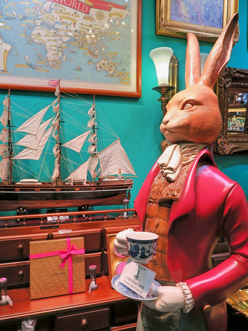 A rabbit serving tea in a tearoom!