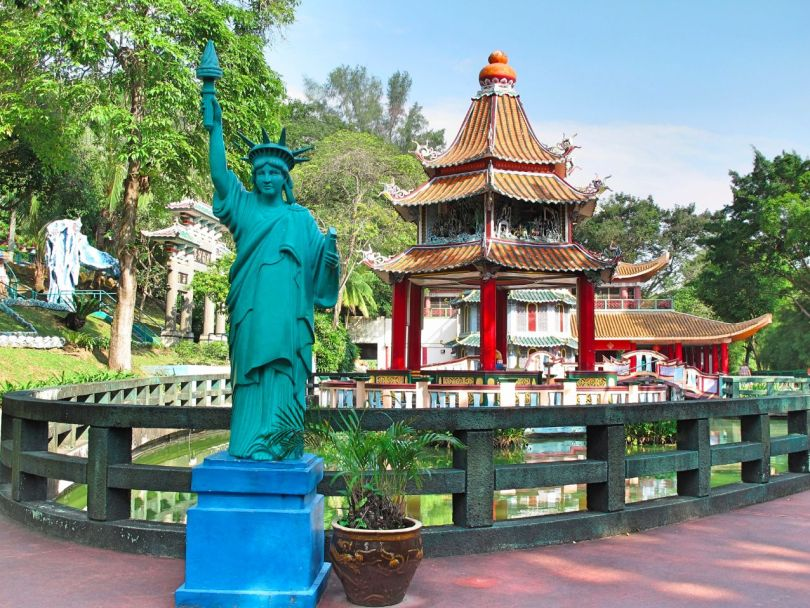 An Asian Statue of Liberty next to a Chinese temple is a good example of what to expect in Haw Par Villa!