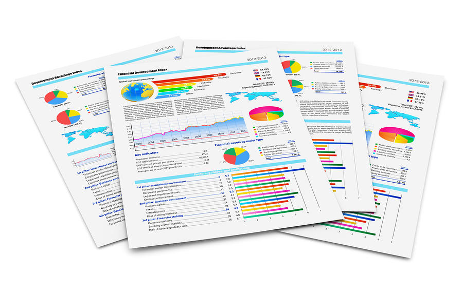 Stack of paper documents with financial reports with color bar graphs pie charts and statistic information data isolated on white background