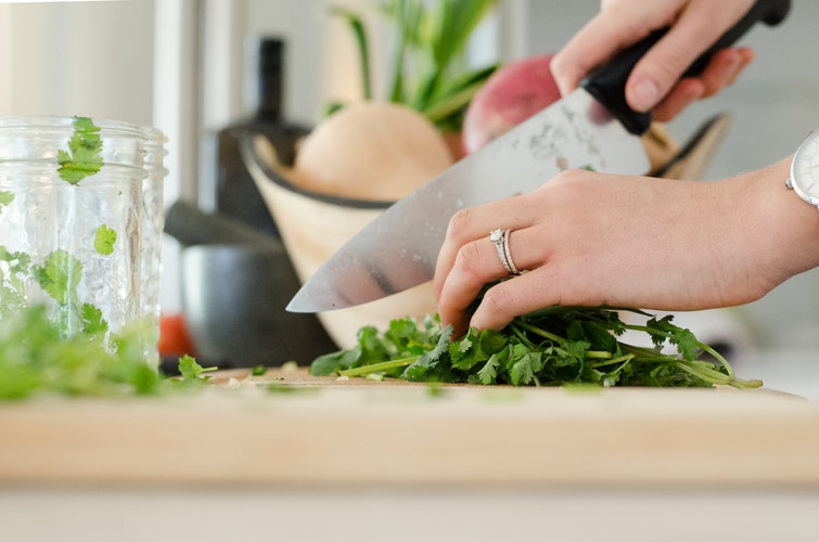 Woman chopping cilantro