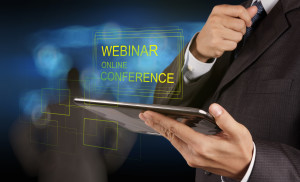 businessman hand show webinar online conference as concept