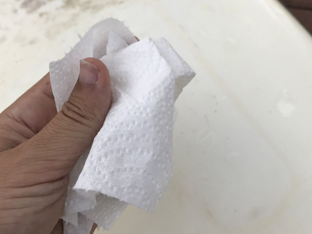 Surfboard Traction Pad Removal - Wiping away excess glue