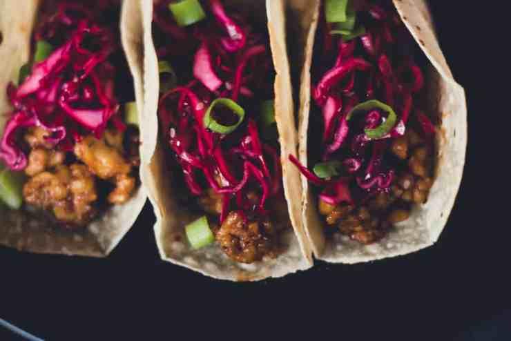 image is a close up of vegan asian tempeh tacos