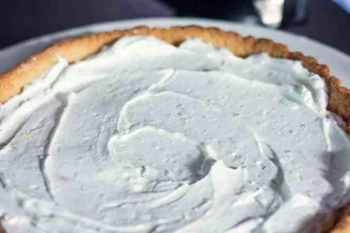 image of spread vegan whipped topping on vegan tart crust