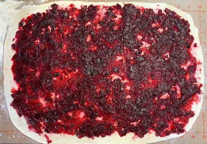 image of cranberry filling spread on vegan sweet dough