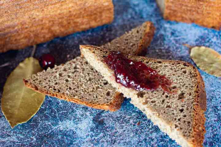 image of all the grains sourdough loaf sliced with jam