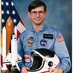 Astronaut Robert J. Cenker