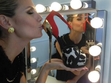 Heidi Klum kisses her Giuseppe Zanottis