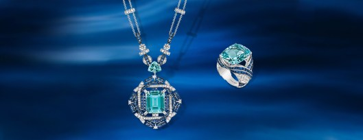 Necklace in white gold transformable into a brooch, with diamonds, sapphires, aquamarines and one emerald-cut aquamarine, and ring in white gold, set with diamonds, sapphires and an cushion-cut aquamarine.