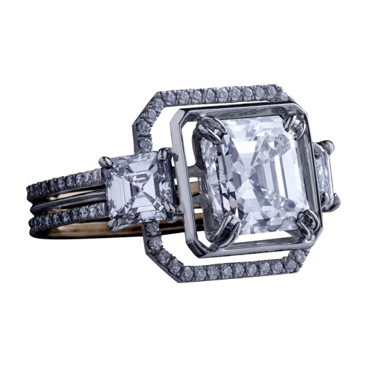 Three-Stone Asscher-Cut Diamond Ring A three-stone ring comprising an Asscher-cut Diamond weighing 3.00 carats and a matching pair of Asscher-cut Diamonds weighing 1.20 carats. Enhanced by an octagon of 1mm knife-edged wire and a band of 1mm 'floating' Diamond melee. Platinum set around a band of 1mm 18-karat yellow gold. Signed by artist. Crafted in the USA. One-of-a-Kind 1/1.