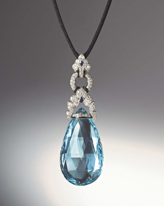 Art Deco aquamarine briolette pendant set with diamonds, two fancy-cut sapphires as well as bands of black enamel set in platinum by Marzo, Paris, circa 1925. Exhibited by Hancocks.