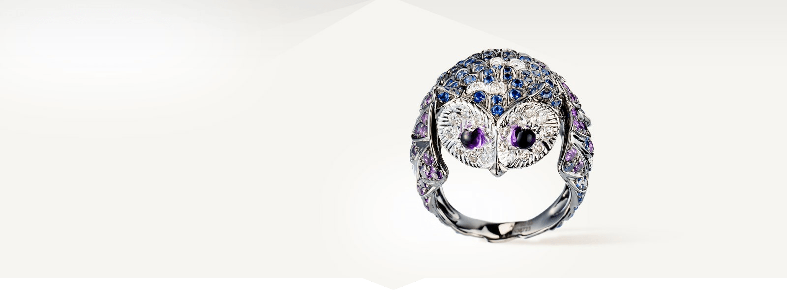 Noctua, the Owl ring by Boucheron. Ring set with pavé amethysts, cabochon amethysts, sapphires and diamonds, in white gold.