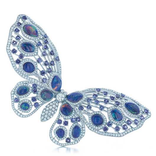 Tiffany & Co. Montana Sapphire and Black Opal Butterfly Brooch. An intricate brooch of round brilliant diamonds, round Montana sapphires and carved black opals in platinum. Carat total weight: black opals, 13.13; Montana sapphires, 5.15; diamonds, 4.58.