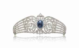 A BELLE EPOQUE SAPPHIRE AND DIAMOND TIARA  Centering upon a collet-set cabochon sapphire in a rose and old-cut diamond scrolling frame, extending tapered openwork diamond-set branches, 1910s. Estimate US$ 31,374 - $52,291.