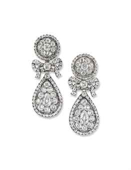 A PAIR OF RARE GEORGIAN DIAMOND EAR PENDANTS (estimate 25,000-35,000). Of typical pendeloque design, each composed of an old-cut diamond pavé-set cluster top to a similarly-set bow design spacer and further pear shaped drop, partially open-set in silver and gold, circa 1810, 4.3cm long, later post fittings.