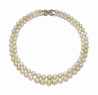 AN ART DECO NATURAL PEARL AND DIAMOND NECKLACE, BY CHAUMET  The two strands composed of forty-five and forty-six graduated natural pearls, measuring approximately 10.5 to 5.4 mm, to the diamond-set clasp, 1930s, shortest strand 39.1 cm, with French assay marks for platinum and gold With maker's mark for Chaumet (partially illegible). Estimate US$ 83,665 - $125,497.
