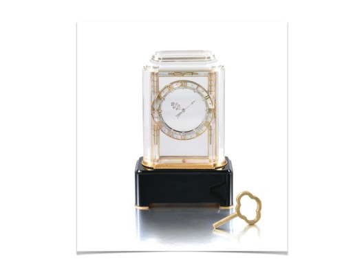 ROCK CRYSTAL, MOTHER-OF-PEARL, ONYX AND DIAMOND 'MODEL A' MYSTERY CLOCK, CARTIER, 1927 The millegrain-set diamond hands set within a gold frame and a chapter ring applied with mother-of-pearl, rose diamonds and raised gold Roman numerals, the bevelled rock crystal case on a onyx rectangular base.