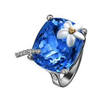 "Limelight ""Blue Hawaiian"" cocktail inspiration ring in 18K white gold and white chalcedony flower, set with one cushion-cut blue topaz, one brilliant-cut yellow sapphire and 121 brilliant-cut diamonds."