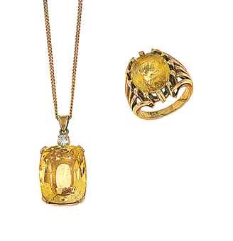 A yellow sapphire and diamond pendant and a yellow sapphire ring The pendant designed as a cushion shaped mixed-cut yellow sapphire in four claw mount with brilliant-cut diamond surmount, to a fine belcher-link neckchain, 3.0cm long; the ring claw-set with an oval mixed-cut sapphire to openwork tapering shoulders. Estimate £2,500-3,000.