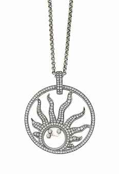 An 18ct white gold 'Happy Diamonds' sun pendant necklace, by Chopard The brilliant-cut diamond-set openwork pendant with free moving brilliant-cut diamond collets in the central glazed compartment, to a brilliant-cut diamond twin row pendant loop and cable-link chain, European Convention marks, pendant 4.1cm long, chain 42.0cm long, maker's pouch Pendant and chain signed Chopard, no. 79/6571/0-20. Estimate £ 2,000-3,000.