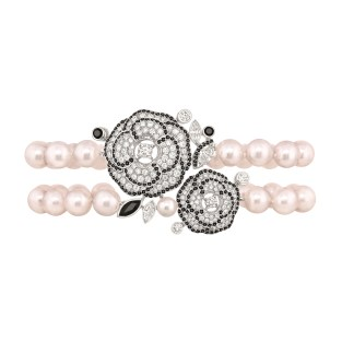 "Les Intemporels de Chanel. ""Camélia Gansé"" bracelet in 18K white gold set with 3 marquise-cut diamonds, 248 brilliant-cut diamonds for a total weight of 3.1"