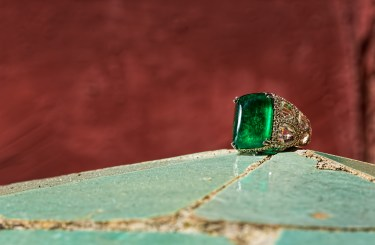 An exceptional Colombian Emerald set on a yellow gold and diamond bold ring.