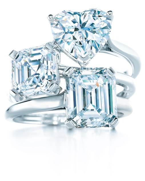 Tiffany engagement rings with fancy-shaped diamonds (from top): heart, square step-cut, emerald-cut.