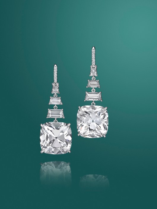 A pair of cushion-cut diamond ear pendants of 10.28 and 10.42 carats. Estimate $600,000 - 800,000.