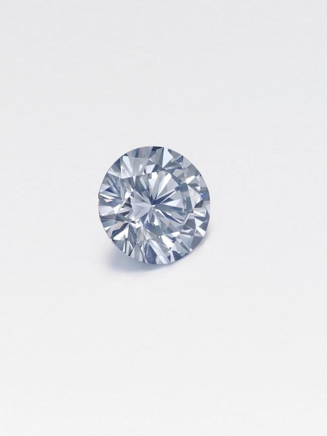A circular-cut fancy gray-blue diamond of 5.04 carats. Estimate $1,750,000 - 2,500,000.