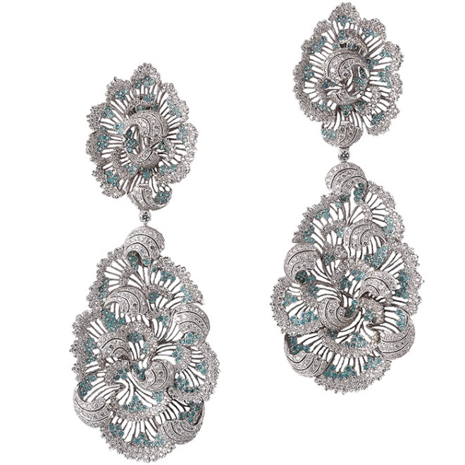 Fabulous one-of-a-kind earrings inspired by ‪Claude Monet‬'s painting. As in Monet's painting, the light is captured within the honeycomb surface of the white gold pendant earrings and then magnified by the Paraiba tourmalines and diamonds.