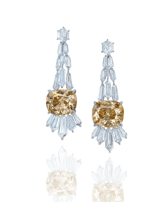 AN UNUSUAL PAIR OF COLOURED DIAMOND AND DIAMOND EAR PENDANTS Each designed as a cascade of elongated hexagonal-shaped diamonds, terminating in a cushion-shaped fancy brown-yellow diamond weighing approximately 18.09 carats or an old mine-cut fancy brown-yellow diamond weighing approximately 15.08 carats, suspended from a hexagonal-shaped diamond surmount, mounted in 18k white gold.
